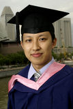 Asian graduate outdoors Royalty Free Stock Images
