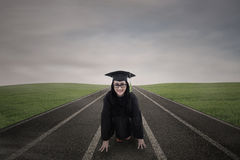 Asian graduate on racing track outdoor Stock Image