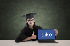 Asian graduate show like on laptop screen Stock Images