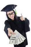 Asian graduate show money - isolated Royalty Free Stock Photo
