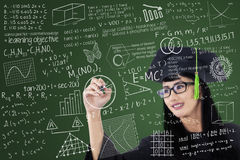 Asian Graduate Writing On Board In Class Stock Images