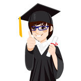 Asian Graduation Boy. Asian student boy on graduation day with diploma and making thumb up hand sign Stock Photos