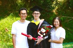 Asian graduation.Education concept. Asian university student and family celebrating graduation outdoor royalty free stock photography