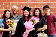 Asian graduation. Asian family celebrate graduation outdoor for family member royalty free stock photo