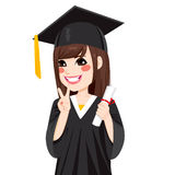 Asian Graduation Girl. Beautiful brunette asian girl on graduation day holding diploma and making victory sign hand gesture Stock Image