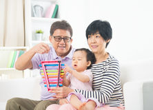 Asian grand parents. With crying grand daugther stock image