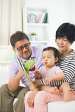 Asian grand parents. With crying grand daugther royalty free stock photo