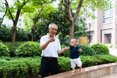 Asian grandfather and grandson Stock Image