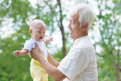 Asian grandfather and grandson Stock Images