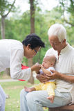 Asian grandfather playing Stock Photography