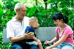 Asian grandfather with two royalty free stock photo