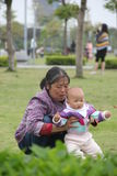 Asian grandmother and granddaughter Stock Images