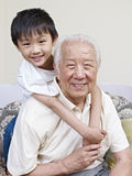 Asian grandpa and grandson. Grandpa and grandson having fun at home stock image