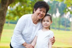 Asian grandparent and grandchild. Asian grandmother and grandchild at outdoor royalty free stock image