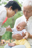 Asian grandparents playing with grandchild Royalty Free Stock Photography