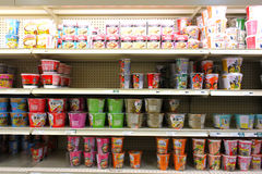 Asian grocery store shelves. Variety of instant noodles with different flavors on the shelves of an Asian supermarket Royalty Free Stock Photos