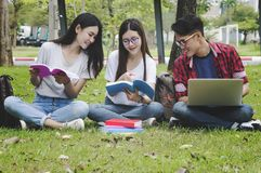 Asian group education, campus, friendship and people concept. Asian group education, campus, friendship and people concept group of happy teenage students with royalty free stock photos