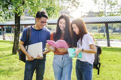 Asian group education, campus, friendship and people concept gro. Up of happy teenage students with school folders stock images