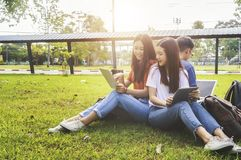 Asian group education, campus, friendship and people concept group. Asian group education, campus, friendship and people concept group of happy teenage students stock photography
