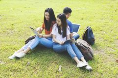 Asian group education, campus, friendship and people concept group of happy teenage students. Asian group education, campus, friendship and people concept group stock photo