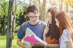 Asian group education, campus, friendship and people concept gro. Up of happy teenage students with school folders royalty free stock photos