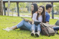 Asian group education, campus, friendship and people concept gro. Up of happy teenage students with school folders stock photo