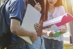 Asian group education reading book study smiling with tablet,lap. Top computer at university high school campus group of happy teenage students with school stock image
