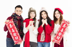Asian group showing Spring festival couplets. Royalty Free Stock Image
