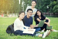 Asian Group of students sharing with the ideas for working on ga Stock Images
