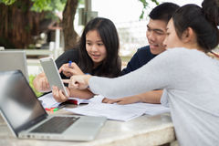 Asian Group of students sharing with the ideas for working on th Royalty Free Stock Photos