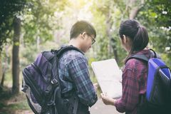 Asian Group of young people Hiking with friends backpacks walkin Stock Images