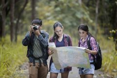 Asian Group of young people Hiking with friends backpacks walkin Royalty Free Stock Photos