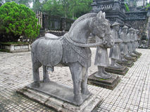Asian guards and horse grey stone statues at Khai Dinh Tomb Royalty Free Stock Photo