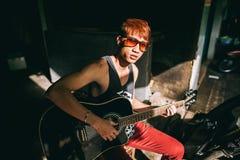 Asian guitarist artist man play guitar on street Stock Images