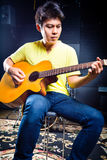 Asian guitarist playing music in recording studio Stock Photography