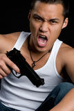 Asian Gun Man Royalty Free Stock Images