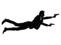 Asian gunman killer jumping shooting  silhouette Stock Photo