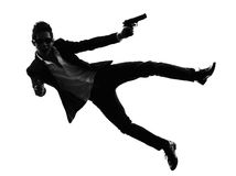 Asian gunman killer jumping shooting  silhouette Stock Photos
