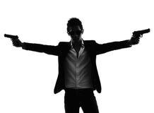 Asian gunman killer  portrait shooting silhouette Royalty Free Stock Photo
