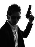 Asian gunman killer  portrait silhouette Stock Photography
