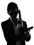 Asian gunman killer  portrait silhouette Stock Photo