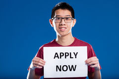 Asian guy asking you to apply now Royalty Free Stock Image