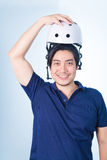 Asian guy with bicycle helmet and gloves Royalty Free Stock Images