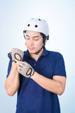 Asian guy with bicycle helmet and gloves Royalty Free Stock Photography