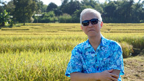 Asian guy in bright shirt at his SME farmland. Abstract own agri Royalty Free Stock Photography