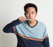 Asian guy brushing teeth Stock Photos