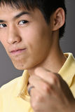 Asian guy with confident expression Stock Photography