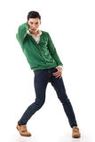 Asian guy with dramatic pose. Full length portrait isolated on white background royalty free stock photography