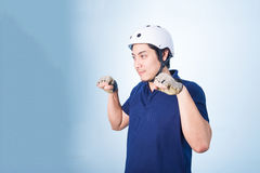 Asian guy gesture biking bicycle, with bicycle helmet and gloves Stock Image