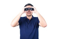 Asian guy holding binoculars, isolated on a white background. Royalty Free Stock Photos